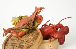 Lobster and asian crab. Lobster and crab on basket royalty free stock image