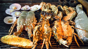 Lobster Barbecue Grill cooking seafood. Royalty Free Stock Images