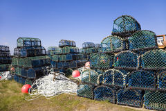 Lobster baskets. Many Lobster baskets on the quayside stock photos