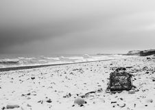 Lobster Beach. A lobster pot washed up during a storm is left stranded on a snow covered beach stock images