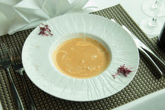 Lobster Bisque Soup with Cream in white dish Stock Photo