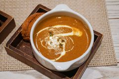 Lobster bisque soup and garlic bread stock photography