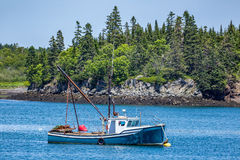 Lobster Boat at Anchor Stock Photo