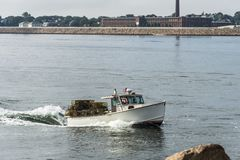 Lobster boat approaching New Bedford hurricane barrier Royalty Free Stock Photography