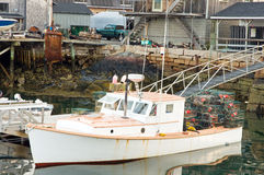 Lobster boat at dock. A view of a typical Maine lobster boat tied to a dock, unloading a day's catch of lobsters.  Southwest Harbor, Maine Royalty Free Stock Photo