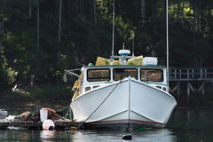 Lobster boat docked in early autumn in South Bristol, Maine, United States. Lobster boat in South Bristol, Maine, New England, US royalty free stock image