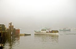 Lobster boat in fog Stock Photo