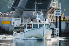 Lobster boat heads out for a beautiful days work in South Bristol, Maine, United States. Lobster boat in South Bristol, Maine, New England, USn stock images
