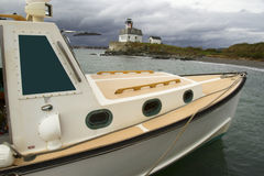 Lobster Boat and Lighthouse Stock Photography