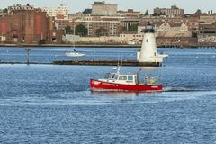 Lobster boat Renegade II passing lighthouse royalty free stock photos