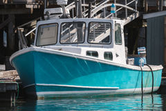 Lobster boat docked in early autumn in South Bristol, Maine, United States. Lobster boat in South Bristol, Maine, New England, US stock images