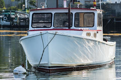 Lobster boat moored in early autumn in South Bristol, Maine, United States. Lobster boat in South Bristol, Maine, New England, US Stock Image