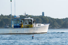 Lobster men hard at work on a beautiful morning in early autumn in South Bristol, Maine, United States Stock Photos