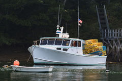 Lobster boat moored in early autumn in South Bristol, Maine, United States. Lobster boat in South Bristol, Maine, New England, USn royalty free stock images