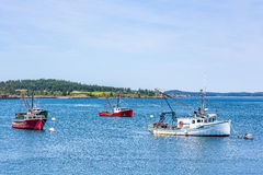 Lobster Boats at Anchor. Lobster boats lay at anchor in a small harbor in the Down East region of Maine Stock Image