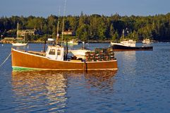 Lobster boats at dawn. A view of two lobster boats in the early morning light, anchored at Southwest Harbor, Maine Stock Photography