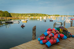 Lobster boats are moored in the harbor at dusk. In Friendship, Maine Stock Photos