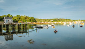 Lobster boats are moored in the harbor at dusk i. N Friendship, Maine Stock Photography