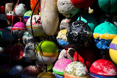 Lobster buoys. Color photo of a variety of hanging lobster trap buoys stock photos