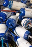 Lobster Buoys. Pile of Blue and white Lobster Buoys Royalty Free Stock Photo