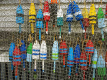 Lobster buoys. And fish net on the side of a shack Stock Image
