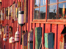 Lobster buoys on shack. Lobster buoys on the side of a wooden shack Royalty Free Stock Image
