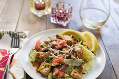 Lobster Caesar salad with a glass of wine Royalty Free Stock Photography
