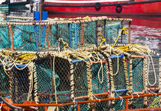 Lobster cages on boat in harbour. A boat with colourful lobster cages stacked on the deck Royalty Free Stock Photography
