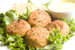 Lobster cakes with lemon wedges tartar sauce Stock Photography