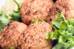 Lobster cakes with lemon wedges tartar sauce Royalty Free Stock Images