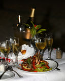 Lobster and champagne glasses on the table Stock Photography