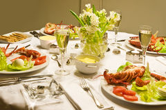 Lobster and champaign. New year dinner with lobster and champaign royalty free stock images