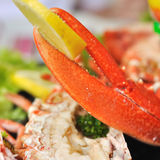 Lobster claw. With a piece of lemon on a seafood platter Royalty Free Stock Photography