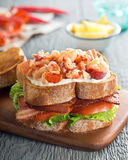 Lobster Club Sandwich. A delicious lobster club sandwich with bacon, lettuce, tomato, and mayonnaise on toasted bread Stock Photography