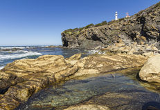 Lobster Cove Head Light and Rocky Shore Royalty Free Stock Photo