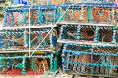 Lobster crab nets. Multi coloured lobster crab nets traps pots piled on harbour side Royalty Free Stock Images