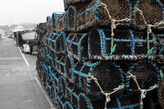 Lobster crab pots stacked on a quayside Royalty Free Stock Photography