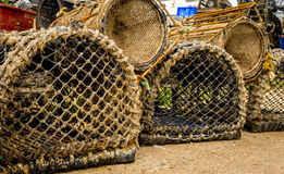 Lobster and Crab Pots. Stacked up on the harbour quayside Royalty Free Stock Photo