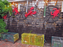 Lobster, crab and sea decorations on building with lobster traps Royalty Free Stock Photo