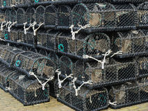 Lobster creels stacked on an English quayside Royalty Free Stock Photography