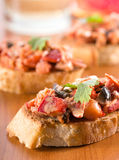 Lobster Crostini. Lobster with mushrooms in a creamy cheese sauce on toasted french bread baguette stock image