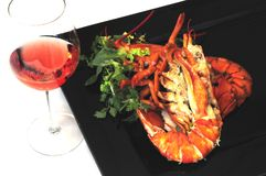 Lobster dinner. A glass of wine and a lobster on a plate stock photo