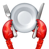 Lobster Dinner Concept. As the red claws of the fresh ocean crustacean holding a fork and knife and blank dish as a gourmet serving symbol isolated on white Stock Images