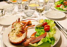 Lobster dinner table Stock Images