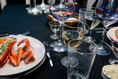 Lobster dinner for two on new years eve. December 31, 2014. A lobster dinner on new years eve 2014 with wine glasses  set upp on a black table Stock Image