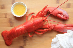 Lobster dinner wooden background no corn Stock Images