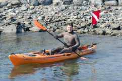 Lobster Diver. Spear fisherman sets out on kayak to go lobster diving along Newport RI coast Stock Images