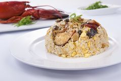 Lobster fired egg and rice on dishes royalty free stock photo