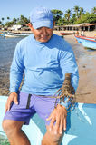 Lobster fisherman on the beach of Los Cobanos Stock Images