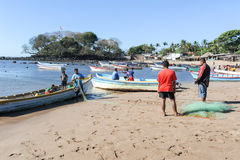 Lobster fisherman on the beach of Los Cobanos Stock Photography